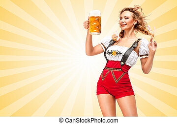 Young flirting sexy woman wearing red jumper shorts with suspenders in a form of a traditional dirndl, holding a beer mug on colorful abstract cartoon style background.