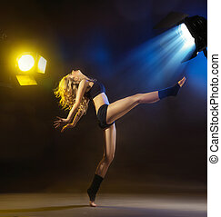 Alluring blond lady in various dance