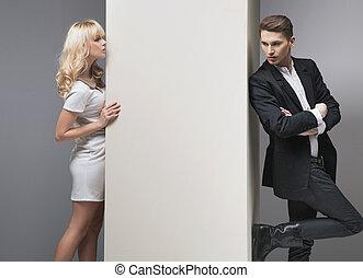 Alluring blonde woman trying to catch her boyfriend -...