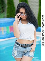 Alluring brunette posing on the street.