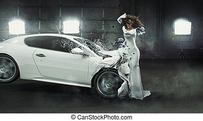 Alluring fashionable woman in the middle of car crash