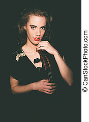 Alluring Female Cellist Holding a Cello Instrument