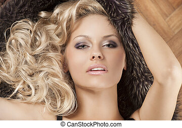 alluring girl with blond curly hair