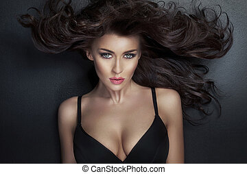 Alluring lady looking at the camera - Alluring woman looking...