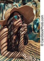 Alluring lady relaxing in a tropical paradise