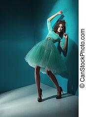 Alluring lady wearing sea-green dress