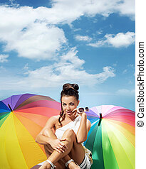 alluring lady with a bunch of colorful umbrellas