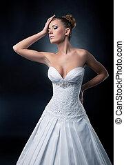 Alluring sexy bride blonde fashion model posing in studio
