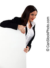 Alluring woman holding up a blank sign