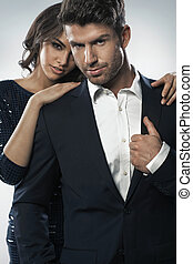 Alluring woman hugging her elegant husband - Alluring woman...