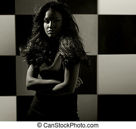 Alluring woman over the chessboard background
