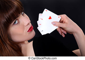 Alluring woman playing cards