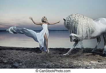 Alluring woman taming the horse