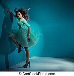 Alluring woman wearing sea-green dress