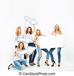 Alluring women pointing the board