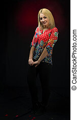 alluring young blonde posing over dark background