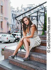 Alluring young lady posing on the street.