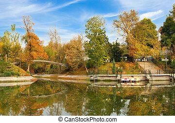 Almaty, Kazakhstan, Gorky Park autumn view with lake and bridge