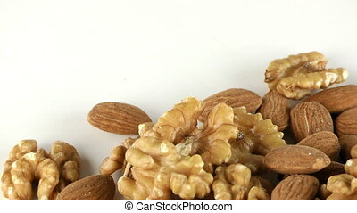 Almond and Walnut on White Background