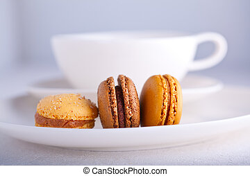 Almond cookies French macaroons with a cup of tea