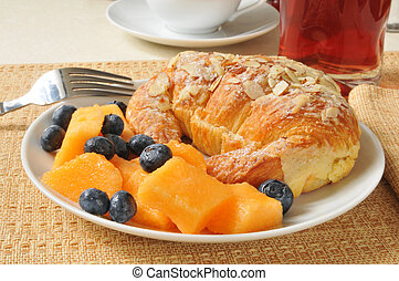 Almond croissant with cantaloupe and blueberries