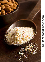 Almond Flour - Raw almond meal (flour) in a wooden spoon....