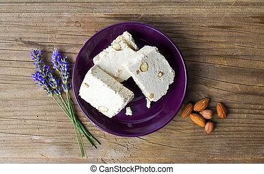 Almond halva slices on a plate