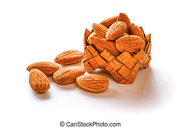 Almond in the basket isolated on white background.