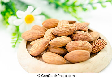 Almond in wooden dish.