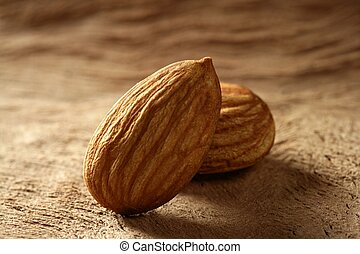 Almond macro over wood background
