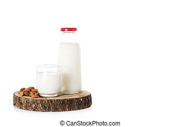 Almond milk isolated on white background