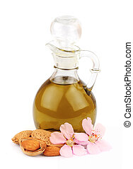 almond oil and almond nuts with flowers