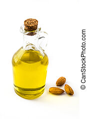 Almond oil in bottle isolated on white background
