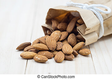 Almond on wood background.