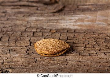 Almond on wooden board