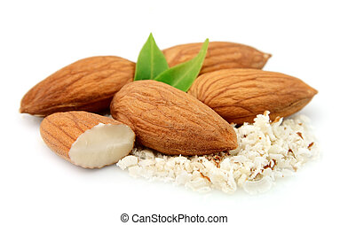 Nuts of almonds with leafs and grated almonds