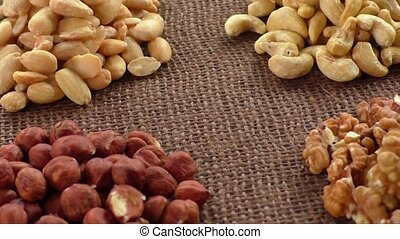 Almonds, cashew, walnuts and hazelnuts lying on burlap
