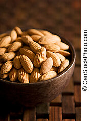 Close-up of a bowl with almonds. Shallow DOF.