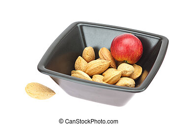 almonds in a bowl and apples isolated on white