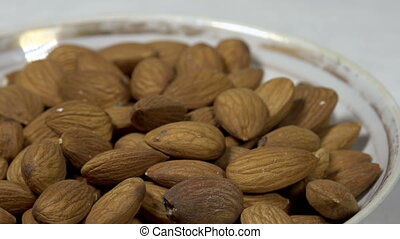 Almonds in a Bowl - Front of the camera rotates dish with...
