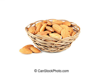 Almonds in basket isolated on white