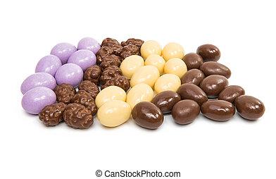 almonds in chocolate glaze on a white background