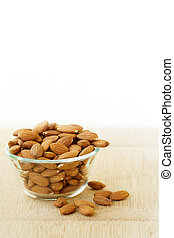 Almonds in glass bowl.