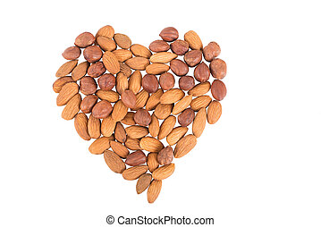 almonds in the form of heart isolated on white background.