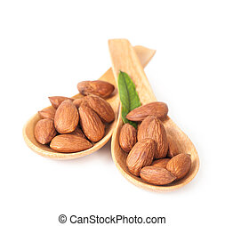 almonds in wood spoon on white background