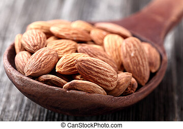 Almonds kernel in a wooden spoon