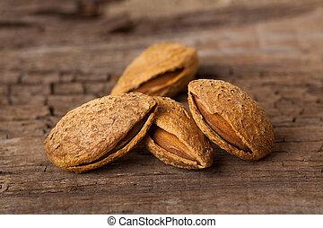 Almonds on wooden board