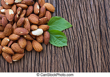 Almonds on wooden table , organic food