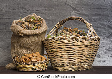 Almonds over rustic wooden board. - Almonds over a rustic...