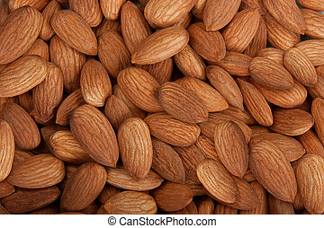 Almonds - Pile of almonds isolated over white background